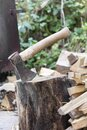 Axe Stuck In Wood Stump