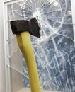 Axe to smash the window glass Stock Photo