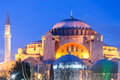 Aya sofia mosque with fountain in night with light at sunset seen from the near park Stock Photography