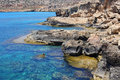 Ayia napa cyprus rocky coastline next to Royalty Free Stock Photos
