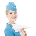 Azafata encantadora holding paper plane a disposición aislado en blanco Fotografía de archivo