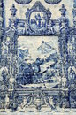 Azulejos on capela das almas in porto portugal azulejo depicting francis of assisi causing a spring of water to flow from a rock Stock Photo