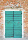 Azure door in the island of giudecca in venice Royalty Free Stock Images