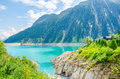 Azure lake with peaks of the Alps, Austria Royalty Free Stock Photo