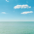 Azure sea and blue sky with clouds Royalty Free Stock Images