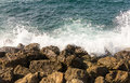 Azure sea white wave is broken about the shore brown stones greece Royalty Free Stock Photo