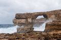 Azure window famous stone arch on gozo island malta Stock Photos