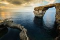 Azure window gozo malta natural arch on island at sunset Stock Image