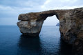 Azure window gozo natural arch on island of malta after the collapse in with a calm sea Royalty Free Stock Photography