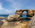 Azure window stone arch of gozo malta famous island in the sun in summer Royalty Free Stock Photo
