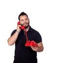 Bärtiger mann der durch telefon spricht Stockfotografie
