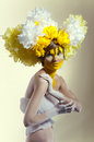 image photo : BИeauty shot with yellow headdress