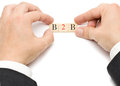 B b hands putting the letters for business to business together Stock Photography