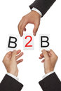 B b hands putting the letters for business to business together Stock Photos