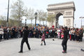 B boy doing some breakdance moves in front a street crowd at arch of triumph april paris france Royalty Free Stock Image