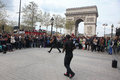 B boy doing some breakdance paris april moves in front a street crowd at arch of triumph april paris france Royalty Free Stock Image