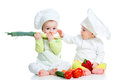 Babies boy girl wearing chef hat healthy food vegetables Stock Photos