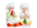 Babies boy girl wearing chef hat healthy food vegetables Stock Image