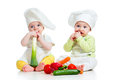 Babies boy girl wearing chef hat healthy food vegetables Royalty Free Stock Photos