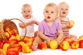 Babies eating apples Royalty Free Stock Photography