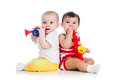 babies girls playing musical toys Royalty Free Stock Photo