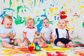 Babies with paints and paintbrushes Stock Photography