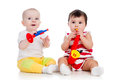 Babies play musical toy girls Royalty Free Stock Photos
