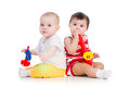 Babies play musical toy kids girls playing with Stock Images