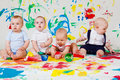 Babies playing with paints Royalty Free Stock Photos