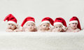Babies with santa hats on bright background cute Royalty Free Stock Photography