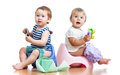 Babies toddlers on chamber pot and playing Royalty Free Stock Images