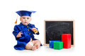 Baby academic with bell and chalkboard in academician clothes Stock Photo