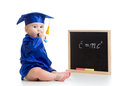 Baby academic with chalk at blackboard girl in academician clothes Stock Photography