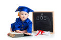 Baby in academic clothes with book at chalkboard girl academician pointer and Stock Photo