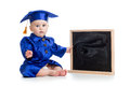 Baby in academician clothes with chalkboard girl Stock Image