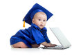 Baby in academician clothes using laptop funny Royalty Free Stock Photography