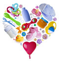 Baby accesories arranged in a heart shape Royalty Free Stock Photo