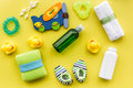 Baby accessories for bath with body cosmetic and ducks on yellow background top view pattern Royalty Free Stock Photo