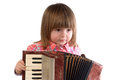 Baby and accordion two year girl trying to play the Royalty Free Stock Photography