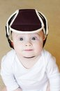 Baby age of months in safety helmet lovely Royalty Free Stock Image