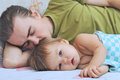 Baby ailing lying with daddy little and Royalty Free Stock Images