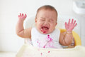 Baby angry and crying girl getting to cry asking for more food Royalty Free Stock Images