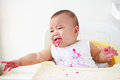 Baby angry and crying girl getting to cry asking for more food Stock Photo