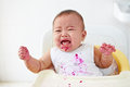 Baby angry and crying girl getting to cry asking for more food Royalty Free Stock Photography
