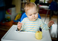 Baby with an apple at home vertical eating Stock Photo