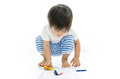 Baby asian is writing little Stock Images