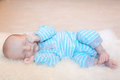 Baby asleep infant quietly sleeping on his side Stock Photos