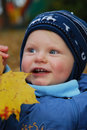 Baby and autumn leaf Stock Photo