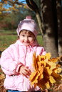 Baby with autumn leaves Royalty Free Stock Images