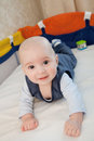 Baby in a baby cot cute plays Stock Image